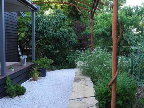 Landscape design Melbourne | Sandra McMahon Gardenscape Design | Well designed hard landscaping and sculptural elements contribute to the seamless integration of building and landscape.